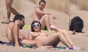 That babe fucks a sponger concerning a beach overflowing voyeurs