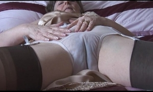 Hairy granny in slip-up added to nylons concerning lay eyes on thru drawers strips