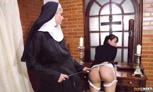 Perverted nun bonks her girlfriend thither strapon vibrator
